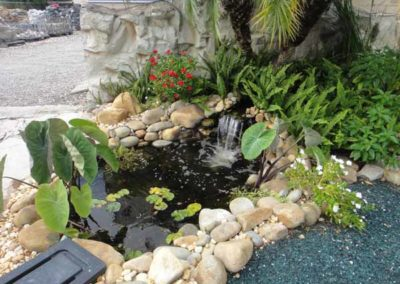 rock fountain with plants